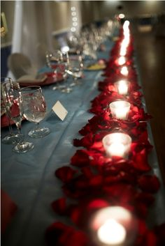 Candles & rose petals make a romantic table runner. Link has beautiful floral ideas. #tablescapes #roses #tablerunners