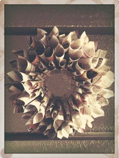 Recycled newspaper wreath.  Going to have to try this...