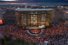 This is truly amazing:)  Théâtre Antique d'Orange/Orange, France Built in the first century, this UNESCO World Heritage site, carved into a hillside in Provence. Nowadays, the theater sees mostly operas, and hosts the world-famous annual festival of Les Chorégies d'Orange, which packs 9,000 seats.