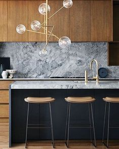 navy, wood and marble kitchen