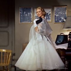 Classic The Embroidery dress in Movie Fitted black bodice with deep V cut down to the bust and rear to the small of the back, off the shoulder neckline, cap sleeves. Full skirt to mid-calf gathered and layered in chiffon and tulle, spray branch patter Grace Kelly Mode, Grace Kelly Wedding, Grace Kelly Style, Grace Kelly Films, Look Vintage, Vintage Glamour, Hollywood Glamour, Classic Hollywood, Grace Kelly Dresses