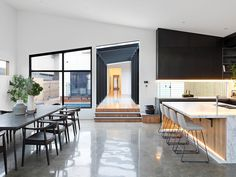 polished concrete floor open plan kitchen dining