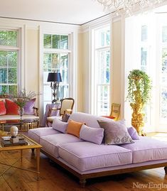 Litchfield County, in a country estate designed by Carole Winer-Sorensen, owner ofCountry Loft Antiques. The Lavenderbanquette in the living room is extraordinary. From the inspirational colour (lavender fields) to it's extra large size and sink-right-in appeal.