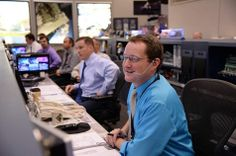 Flight Director Matt Abbott (foreground) monitors the SpaceX Dragon activities at his console in the International Space Station flight control room at Houston's Mission Control Center. — with Phillip Zulu, Ranjan Soni, Jim Cooney and Shiv Prasad at NASA's Johnson Space Center.