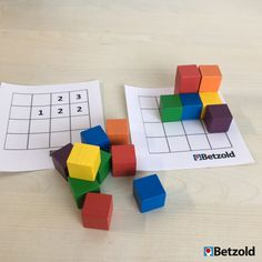 A lot can be done with the small, colorful wooden cubes. For example… - Bildung Kindergarten Math Activities, Activities For Boys, Preschool Math, Montessori Art, Learning Games For Kids, Busy Boxes, Wooden Cubes, Grande Section, Math School