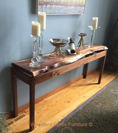 This functional work of art is part of our Contemporary Rustic Collection and features a sculptural like quality. Don't be fooled though, this modern rustic sofa table is perfect for any room and is as functional as it is beautiful. Crafted using solid Black Walnut, this contemporary wood design is hand-made by our skilled artisans