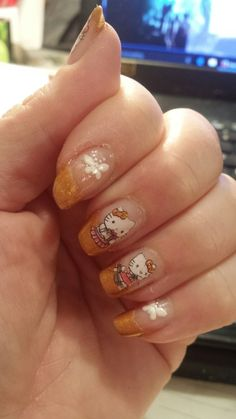 Day 14 - Cartoon Character - I really can not get enough of these Hello Kitty Water Transfers. I love the look of them over a french tip.  Nina Ultra Pro Gold Nugget
