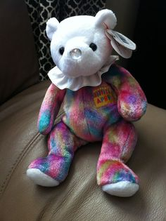"""Rare Beanie Baby """"April"""" birthday bear. Poem: April My nose is the color of my birth stone Diamond It brings intelligence and non-stop adventure!!"""