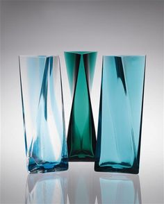 "TADAO ANDO  Set of three vases, 2011  Colored glass.  First artist's proof. Produced by Venini, Italy. Each is the first artist's proof from their respective editions of 30. Underside of each vase acid etchedwith ""90/VENINI/2011/ANDO"" and ""venini 2011 – 1 / 9 P.d.A"" and with manufacturer's sticker with ""90/1921/2011/VENINI."" Together with a certificate of authenticity from Venini (3).  Each: 22 1/4 in. (56.5 cm.)  ESTIMATE $40,000-50,000     SOLD AT $80,500"