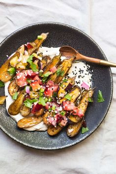 Can't wait to try this! This Roasted Miniature Eggplant with Tahini Yogurt and Plum Salsa is the perfect vegetable side dish for any weeknight meal.
