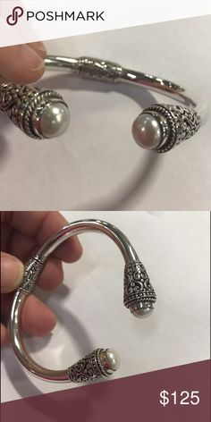 Bali bangle with pearls gorgeous detail! NWOT 925 Sterling silver genuine pearl bali bangle cuff   Open to offers, ask any questions you may have.   Always up for suggestions on items to add to my shop, let me know what your looking for!  Similar to Kendra Scott , Tiffany & co ,  silpada , Pandora , James Avery , Alicia Jean , sculptural , mine finds by jay king , David Yurman , ippolita , zina Eva ,   Resellers welcome Jewelry Bracelets
