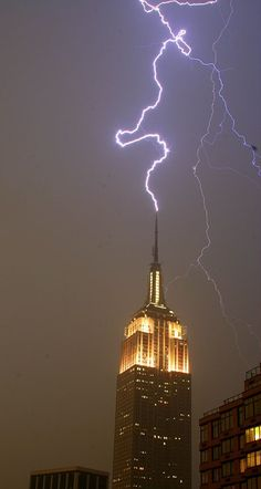 Lightning storm in New York (2006) by GrahamF. The Empire State Building is hit nearly 100 times a year by lightning.