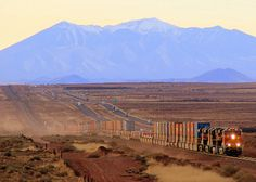 Nearing sunset, a BNSF intermodel train climbs the grade eastbound nearing Winslow, Arizona.