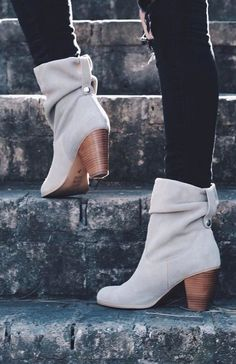 Light gray suede boots.
