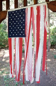 Shabby American flag created with scraps of fabric and lace.