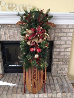 Sled project, 2015. Took an old sled, repainted the metal runners and frame, added a string of white mini-lights to the slats on the sled, wired on some greenery, pinecones, a few ornaments, and made the bow with wired ribbon. !Voila! Cool holiday decoration for porch or hearth.