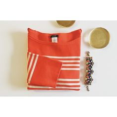 J. Crew Sweater Cute orange/off white striped sweater. Perfect to wear over a button down shirt. Boat neck. Front pockets. Quarter sleeves. 80% Cotton, 17% Nylon, 3% Spandex. Worn once. J. Crew Sweaters