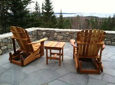 "Oversized Adirondack gliders finished in a ""gold"" transparent stain / sealer"