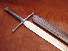 Wolf sword with scabbard Swords And Daggers, Knives And Swords, Cool Knives, Fantasy Sword, Fantasy Weapons, Great Sword, Knight Sword, Cool Swords, Woodworking Power Tools