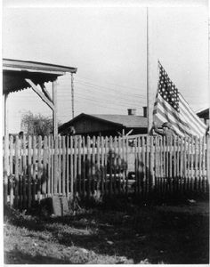 """This happened on April 29, 1945. Pic from the Stalag Luft III website. Caption, """"A very emotional moment as the American flag replaces the Nazi flag. Saluting troops cast respectful shadows on the fence."""" Every account I've read about this says this was the moment of a lifetime."""