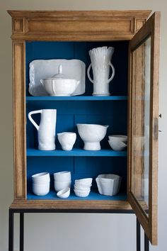Painting the insides of cabinets and drawers is a great way to add accent color to the