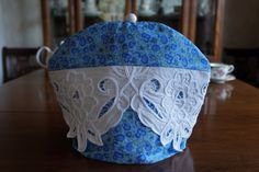 Shabby Chic Blue Paisley Floral Print Insulating Fabric Tea Cosy / Cozy with Battenberg Lace Trim and Custom Polymer Clay Bead Pull Top $50.00 CAD