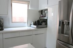 Using a slide out drawer within an end cabinet as an appliance garage. Hides appliances, but makes them readily available. Could be perfect for Thermomix and Toaster, especially if there is electrical in the cabinet so that they are already plugged in.