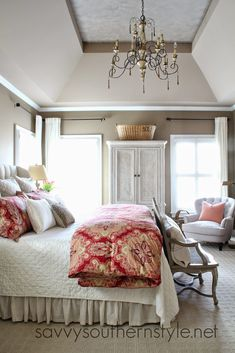 Master bedroom, Pottery Barn bedding, Restoration Hardware vintage linen quilt, French bench, chandelier, tray ceiling, upholstered headboard