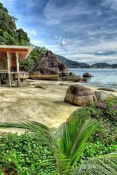 ✮ Beach at Pangkor Laut off the West Coast of Malaysia along the Straits of Malacca tropical island with rocky outcrops and beautiful rain forests