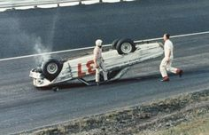 vintage nascar pics | Bob Strickler climbs out of his overturned Ford after a crash in the ...