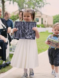 Here comes your girl chalkboard sign. (sidenote ... everyone in this wedding wore high top tennis shoes. cute!)