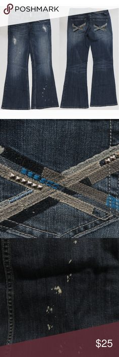 """Vigoss jeans 7 The New York Flare distressed Distressed 5 pocket jeans. The back pockets are embroidered and embellished with studs. Two button and zipper closure. These are """"The New York Flare.""""  Brand: Vigoss Size: 7 Made in: China Materials: 98% cotton, 2% spandex  Condition: Very good. Factory distressing. Wear on the bottom hems. Spot above the back right pocket.  Flat measurements in inches: Waist (A): 15 1/4 Inseam (B): 31 Outseam (C): 40 Leg opening (D): 11 1/2 Front rise (E): 8 1/2…"""