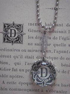 initial necklace made from a book page