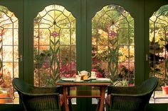 What a wonderful place to sit and read or eat a casual meal. I love the view of the sunny garden through the stained glass windows.