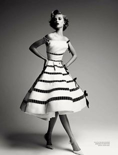 This is an awesome dress!!  Must remake this white dress & black trim!