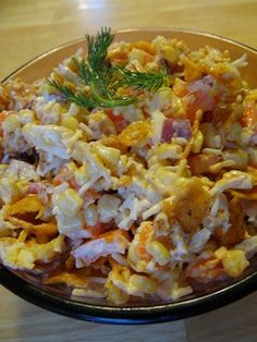 Paula Deen Frito and Corn Salad Recipe~love this!! 2 (15 ounce) cans whole kernel corn, drained -or fiesta corn 2 cups grated cheddar cheese  1 cup mayonnaise 1 cup green pepper, chopped 1/2 cup red onion, chopped 1 (10 1/2 ounce) bag coarsely crushed Fritos chili cheese corn chips- or regular Fritos  Directions:  Mix first 5 ingredients and chill. Stir in corn chips just before serving!   Enjoy!