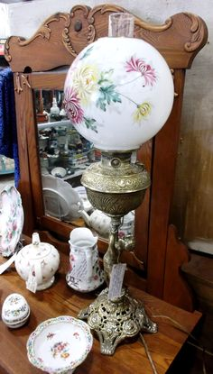 This antique cherub lamp has a solid brass base with a hand painted milk glass globe. Converted from oil to electricity it is available in P804 for $445.00.  1400 Squires Beach Road, Pickering, ON L1W 4B9. 905) 427-7902. www.roadshowantiquespickering.com Beach Road, Glass Globe, Cherub, Milk Glass, Solid Brass, Base, Hand Painted, Oil, Lighting