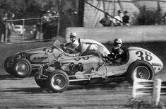 Looks like Bob Sweikert on the outside...Big Cars on the dirt...