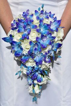 Stunning Galaxy Blue Orchid and Ivory Rose Cascading Bouquet