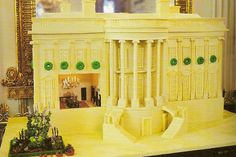 Gingerbread White House replica made by pastry chef Bill Yosses in 2009. It was covered with white chocolate, and included Michelle Obama's vegetable garden. The room was filled with dark chocolate furniture, and lit with a dollhouse chandelier.