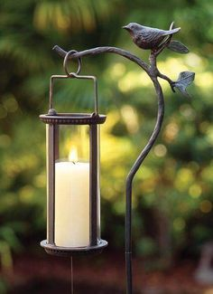 garden lantern available from: https://www.charlestongardens.com/products/Bird-Lantern-Stake/3152