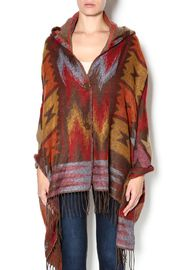 Soft and subtle striped fringe Aztec shawl with brown toggle button.