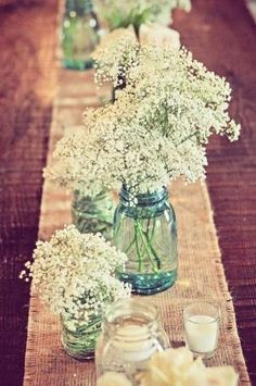 I have plenty of mason jars + add baby's breath (or flowers from yard) = cheap center pieces! by adeline