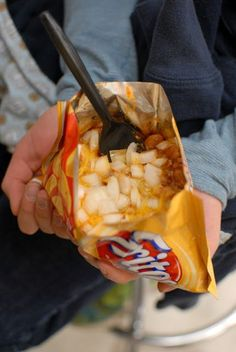 Camping food!!     Pinner says: Frito pie, a delicacy of the American Southwest, consists of Frito chips, chili, cheese, beans and onions. Its origins are a mystery, but one legend places its birth at a Woolworth's lunch counter in Santa Fe, New Mexico. Woolworth's isn't around anymore, but a dime store still resides at that location. It serves Frito pie at a snack bar in the back, with the ingredients poured into a slit open Frito bag.