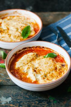 Herb, cottage cheese and mascarpone dumplings gratin with fresh tomato sauce.  This dish is awesome for a quick, delicious and easy to prepare midweek lunch / dinner. The tomato sauce is fresh and juicy, dumplings are light and airy and the gratin just adds that indulgent texture. Love it. | jernejkitchen.com