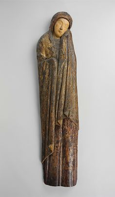 'Mourning Virgin, mid-13th century, Umbria probably.   Poplar covered with canvas, gesso,and tin foil; oil glazes.