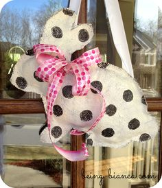 DIY burlap bunny instead of a front door wreath this spring. Cute Easter decor, too!