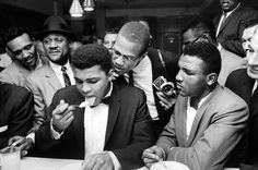 Muhammad Ali – This is a scene from a party after Clay beat Sonny Liston for the heavyweight title. Such is the power of his celebrity, the assembled crowd are jostling around him simply to watch him eat. The proximity of Malcolm X to Clay serves as a neat metaphor for the closeness of their relationship at that time. Photograph: Bob Gomel/The LIFE Images Collection/Getty
