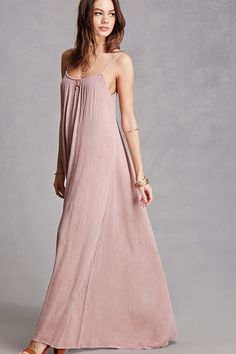 A crinkled woven maxi dress by Boho Me™ featuring a scoop neckline, scoop back, cami straps, a flared hem, and a woven underlay.