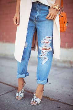 Distressed boyfriend jeans, snakeskin heels, and a long blush best with an orange bag via Song of Style #style #fashion
